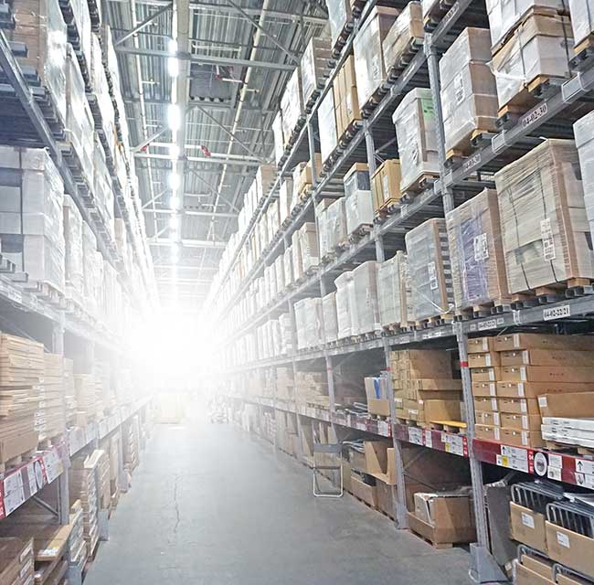 warehouse interior with goods stacked high on shelves
